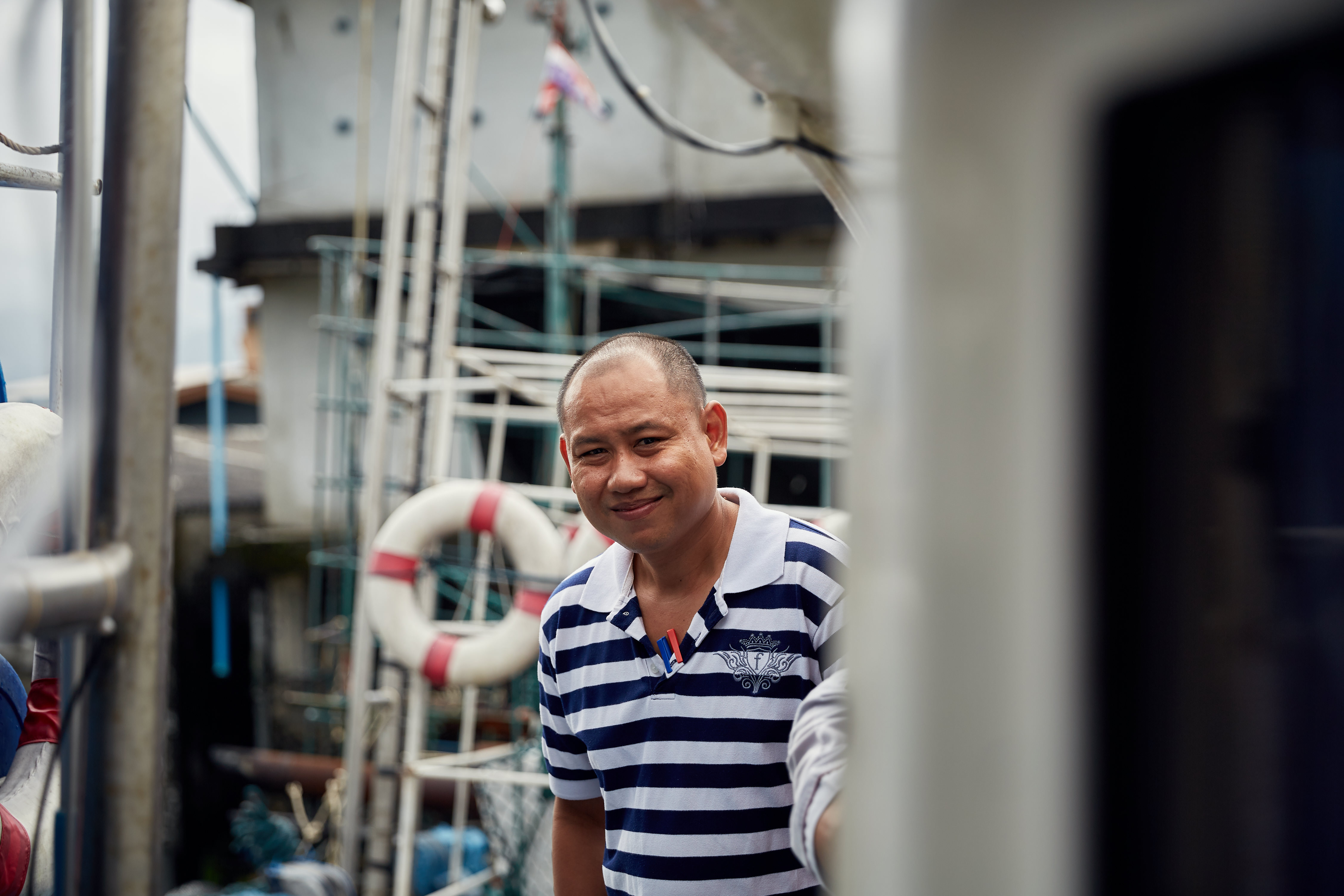 A man smiling onboard a fishing vessel in the south of Thailand. Photo credit: Thai Union