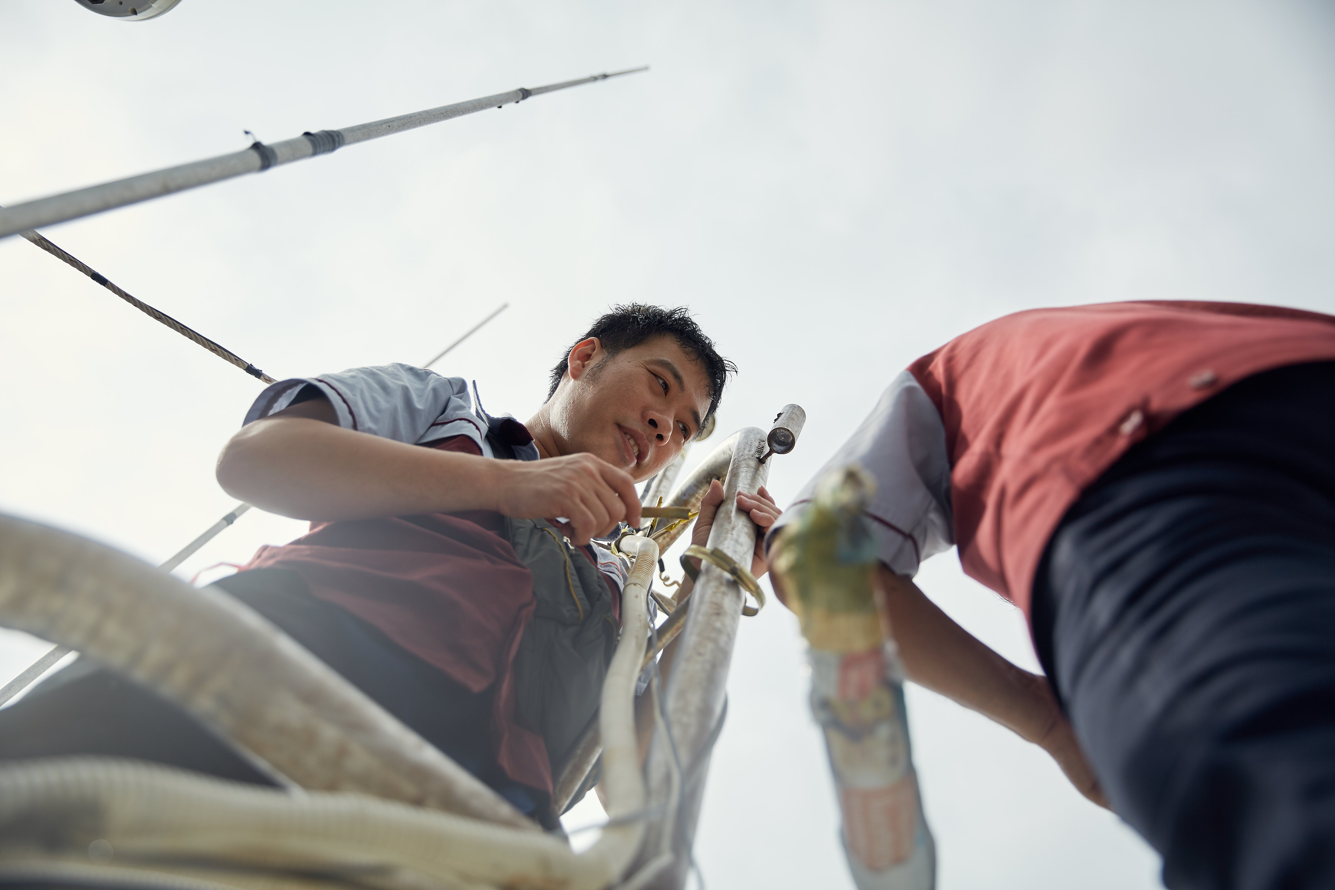 Teams work to install technology on a Thai fishing vessel to bring digital traceability to Thailand's fishing industry. Photo credit: Thai Union